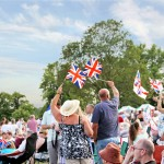 Battle Proms crowd with flags and Spitfire